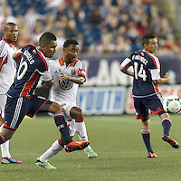 New England Revolution midfielder Juan Agudelo (10) and D.C. United defender James Riley (2) eye a loose ball. In a Major League Soccer (MLS) match, the New England Revolution (blue) tied D.C. United (white), 0-0, at Gillette Stadium on June 8, 2013.