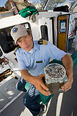"Captain Charles Moore, the man credited for first discovering the plastic soup in the Gyre over 10 years ago, showing plastic samples collected in the North Pacific Gyre.  The ORV Alguita returns to Long beach after four months at sea sampling the waters of the ""great Pacific garbage patch"" in the North Pacific Subtropical  Gyre (NPSG). The Algalita Marine Research Foundation has been studying and educating the public about the effects of oceanic micro-plastic pollution on the ocean's ecosystem and marine life for over ten years. Long Beach, California, USA."