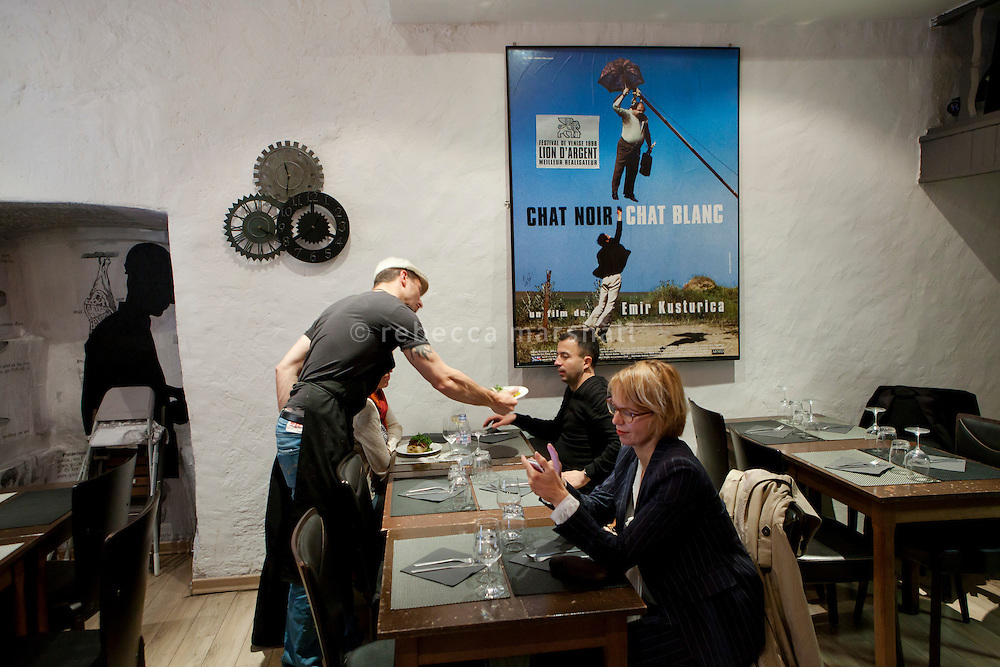 Chef Giorgio Grilenzoni serves diners at the restaurant 'Chat Noir, Chat Blanc', Nice, France, 10 April 2012