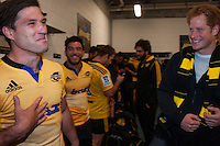 Prince Harry chats with Cory Jane in the Hurricanes changing rooms after the Super Rugby match between the Hurricanes and Sharks at Westpac Stadium, Wellington, New Zealand on Saturday, 9 May 2015. Photo: Dave Lintott / lintottphoto.co.nz