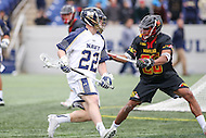 Annapolis, MD - February 11, 2017: Navy Midshipmen Colin Flounlacker (22) is being defended by Maryland Terrapins Isaiah Davis-Allen (26) during game between Maryland vs Navy at  Navy-Marine Corps Memorial Stadium in Annapolis, MD.   (Photo by Elliott Brown/Media Images International)