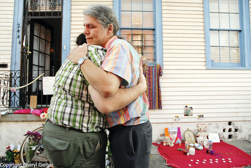 Two men embrace at the scene of murder victim Helen Hill, 2006