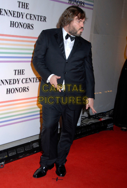 JACK BLACK .31st Kennedy Center Honors celebrating lifetime achievement in the performing arts held at the Kennedy Center for the Performing Arts,  Washington, D.C. 7th December 2008..full length suit tuxedo hands funny pose  black bow tie profile .CAP/ADM/GB.©Gary Boas/Admedia/Capital Pictures