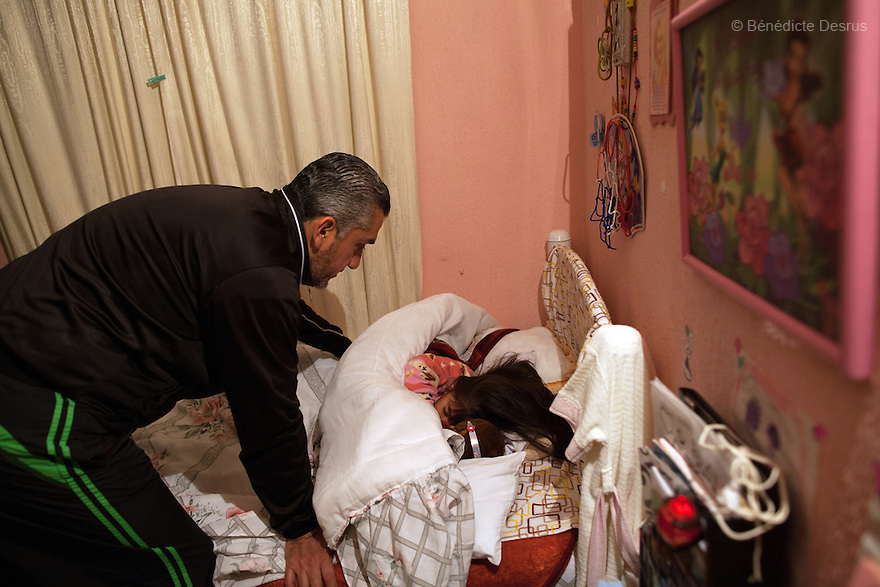 "Donovan says goodnight to his daughter before she goes to sleep at their home in Texcoco, Mexico on February 1, 2016. Donovan Tavera, 43, is the director of ""Limpieza Forense México"", the country's first and so far the only government-accredited forensic cleaning company. Since 2000, Tavera, a self-taught forensic technician, and his family have offered services to clean up homicides, unattended death, suicides, the homes of compulsive hoarders and houses destroyed by fire or flooding. Despite rising violence that has left 70,000 people dead and 23,000 disappeared since 2006, Mexico has only one certified forensic cleaner. As a consequence, the biological hazards associated with crime scenes are going unchecked all around the country. Photo by Bénédicte Desrus"