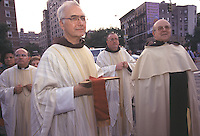 "(021030-SWR04.jpg) New York, NY --Priests from St Anthony of Padua Roman Catholic Church march inthe annual procession through the streets of Greenwich Village and Soho.k  The procession is the culmination of a two week long ""Feast""  or Italian Street Festiival that runs several blocks long in the Italian American neighborhood of New York...Photo Stacy Walsh Rosenstock.stacy@stacyrosenstock.com"