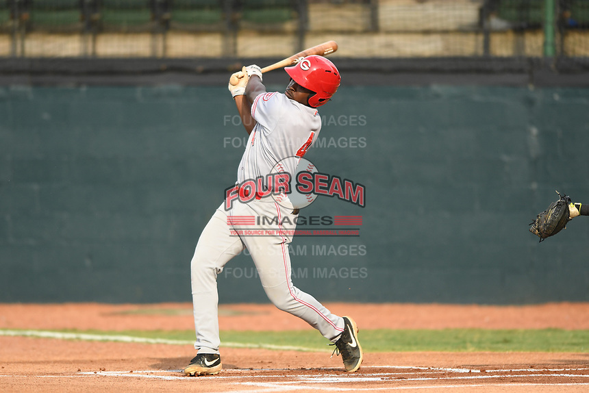 Ivan Johnson (4) of the Greeneville Reds follows through on his swing against the Bristol Pirates at Boyce Cox Field on July 31, 2019 in Bristol, Virginia. The Pirates defeated the Reds 13-3. (Tracy Proffitt/Four Seam Images)