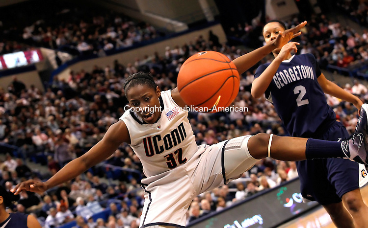 Hartford, CT-27, February 2010-022710CM01    UCONNS's Kalana Greene watches the ball go out of bounds, after going up for two. UCONN met  Georgetown Saturday afternoon at the XL Center Hartford.  Behind her is Latia Magee (#2) of Goergetown.   Greene scored 13, as the Huskies beat the Hoyas 84-62.      --Christopher Massa Republican-American