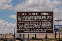Rio Puerco Bridge<br /> This Parker Through Truss located on historic Route 66 was built in 1933. It was fabricated by the Kansas City Structural Steel Company and erected by F.D. Shufflebarger of Albuquerque. Its 250 length is one of the longest in New Mexico. Repairs and remodeling were completed in 1957. This structure was replaced in 1999 and is being preserved by the New Mexico State Highway and Transportation Department.