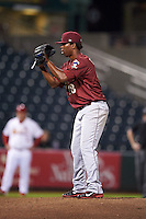 Frisco RoughRiders pitcher Edwar Cabrera (18) gets ready to deliver a pitch during a game against the Springfield Cardinals on June 3, 2015 at Hammons Field in Springfield, Missouri.  Springfield defeated Frisco 7-2.  (Mike Janes/Four Seam Images)