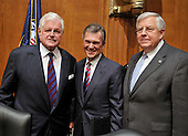 """Washington, D.C. - January 8, 2009 -- Former United States Senator Tom Daschle (Democrat of South Dakota), center, poses for a photo with United States Senator Edward M. """"Ted"""" Kennedy (Democrat of Massachusetts), left, Chairman of the United States Senate Committee on Health, Labor, Education, and Pensions and its ranking member, United States Senator Mike Enzi (Republican of Wyoming) prior to giving testimony on his nomination to be Secretary of Health and Human Services in Washington, D.C. on Thursday, January 8, 2009..Credit: Ron Sachs / CNP"""