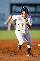 Rangel Ravelo #25 of the Bristol White Sox hustles towards third base against the Greeneville Astros at Boyce Cox Field July 1, 2010, in Bristol, Tennessee.  Photo by Brian Westerholt / Four Seam Images