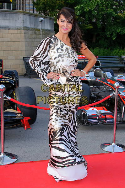 Lizzie Cundy.The F1 Party held at the Natural History Museum, London, England..July 6th, 2011.full length black white dress zebra animal leopard print one shoulder sleeve hands on hips .CAP/CJ.©Chris Joseph/Capital Pictures.