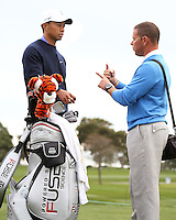 23 JAN 13  Tiger Woods chatting with swing coach Sean Foley during The Farmers Insurance Open at Torrey Pines Golf Course in La Jolla, California. (photo:  kenneth e.dennis / kendennisphoto.com)