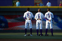 (L-R)  Winston-Salem Dash outfielders Joel Booker (3), Alex Call (8), and Blake Rutherford (9) stand for the National Anthem prior to the game against the Lynchburg Hillcats at BB&T Ballpark on May 1, 2018 in Winston-Salem, North Carolina. The Dash defeated the Hillcats 9-0. (Brian Westerholt/Four Seam Images)
