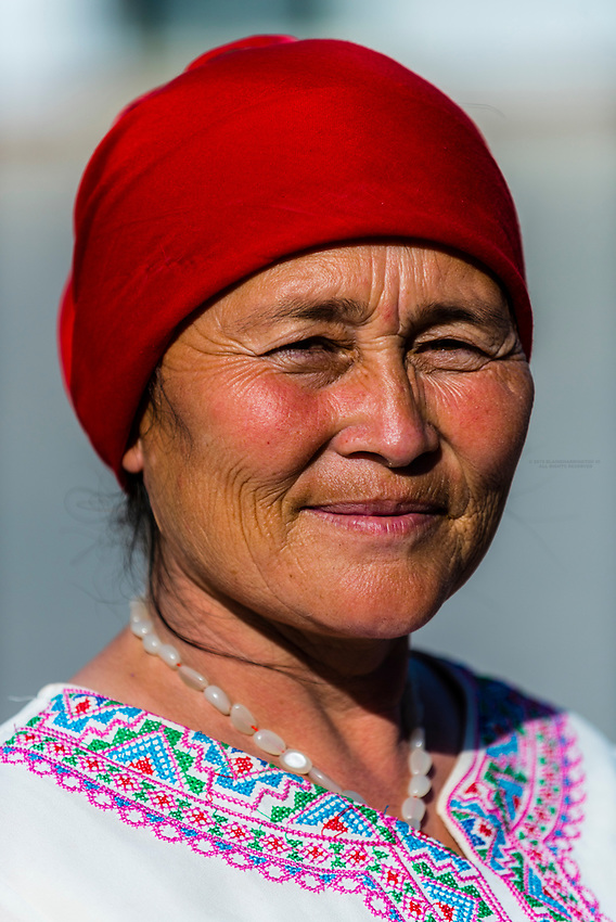 A Uyghur woman, Turpan, Xinjiang Province, China. Turpan is a small oasis town and former Silk Road outpost. Uyghur people are a Central Asian people of Muslim Turkic origin. They are China's largest minority group.