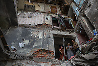 People look for their belongings in their house destroyed by airstrike. Snizhne, Ukraine.