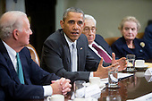 United States President Barack Obama, second left, speaks while meeting with current and former diplomatic and national security officials including James Baker, former U.S. Secretary of State, from left, Obama, Henry Kissinger, former U.S. Secretary of State, and Madeleine Albright, former U.S. Secretary of State and founder of Albright Stonebridge Group LLC, to discuss the Trans-Pacific Partnership (TPP) in the Roosevelt Room of the White House in Washington, D.C., U.S., on Friday, November 13, 2015. Obama, hoping to kick off a new phase of selling the TPP at home while enhancing its prospects overseas, has enlisted some of the nation's top national security leaders to give testimonials. <br /> Credit: Andrew Harrer / Pool via CNP
