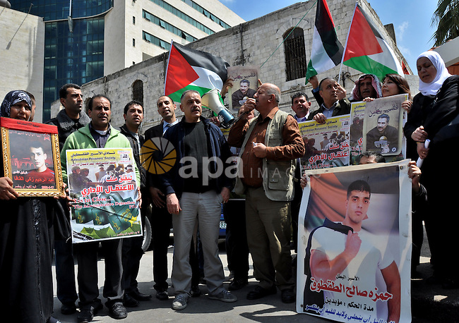 Palestinians participate in a demonstration in solidarity with prisoners jailed in Israel, in the West Bank city of Nablus, Apr. 03, 2012. Photo by Nedal Shtieh