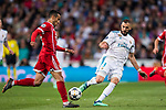 Karim Benzema (R) of Real Madrid fights for the ball with Corentin Tolisso of FC Bayern Munich during the UEFA Champions League Semi-final 2nd leg match between Real Madrid and Bayern Munich at the Estadio Santiago Bernabeu on May 01 2018 in Madrid, Spain. Photo by Diego Souto / Power Sport Images