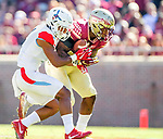Florida State defensive back Derwin James intercepts a  Delaware State pass intended for Fatu Sua-Godinet in the first half of an NCAA football game in Tallahassee, Fl.  Florida State defeated Delaware State 77-6.