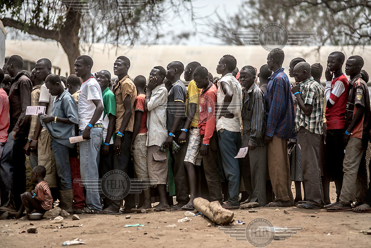 Recently arrived refugees from South Sudan queue up to register at the Imvepi reception centre in northern Uganda.