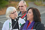 Sofia Estevez (right), pastor of evangelism at Highline United Methodist Church in Burien, Washington, speaks outside the Federal Detention Center in Seatac, Washington, during a June 24 prayer vigil in support of immigrant parents inside the prison who've been separated from their children.