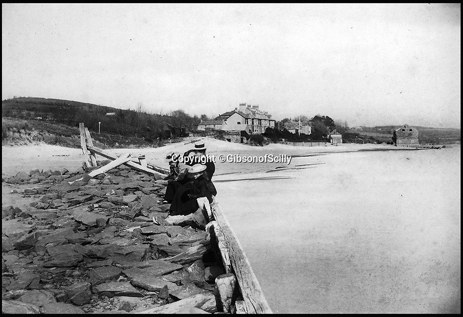 BNPS.co.uk (01202 558833)<br /> Pic: GibsonOfScilly/BNPS<br /> <br /> Now trendy Rock around 1900.<br /> <br /> An archive of eye-opening photographs documenting the grim reality of Poldark's Cornwall has emerged for sale for &pound;25,000.<br /> <br /> More than 1,500 black and white images show the gritty lives lived by poverty-stricken families in late 19th and early 20th century Cornwall - around the same time that Winston Graham's famous Poldark novels were set.<br /> <br /> The collection reveals the lowly beginnings of towns like Rock, Fowey, Newquay and St Ives long before they became picture-postcard tourist hotspots.<br /> <br /> Images show young filth-covered children playing barefoot in squalid streets, impoverished families standing around outside the local tax office, and weather-beaten fishwives tending to the day's catch.<br /> <br /> The Cornish archive, comprising 1,200 original photographic prints and 300 glass negative plates, is tipped to fetch &pound;25,000 when it goes under the hammer as one lot at Penzance Auction House.