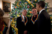 President Barack Obama greets Robert DeNiro and Bruce Springsteen at a reception for the Kennedy Center Honors  recipients in the Blue Room of the White House, Dec. 6, 2009.  (Official White House Photo by Pete Souza)<br /> <br /> This official White House photograph is being made available only for publication by news organizations and/or for personal use printing by the subject(s) of the photograph. The photograph may not be manipulated in any way and may not be used in commercial or political materials, advertisements, emails, products, promotions that in any way suggests approval or endorsement of the President, the First Family, or the White House.