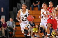 28 January 2012:  FIU guard Jerica Coley (22) breaks for the basket in the second half as the FIU Golden Panthers defeated the Western Kentucky University Hilltoppers, 60-56, at the U.S. Century Bank Arena in Miami, Florida.  Coley, who has scored the second-most points of any women's player in the country, finished the game with 36 points and surpassed the 1,000 point mark.