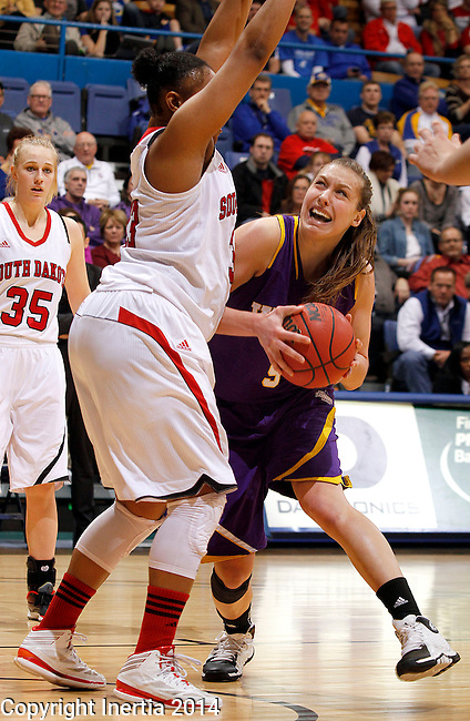 SIOUX FALLS, SD - MARCH 9:  Ashley Luke #5 from Western Illinois takes the ball to the basket against Polly Harrington #33 from the University of South Dakota in the second half of their semifinal game at the 2014 Summit League Tournament in Sioux Falls, SD.  (Photo by Dave Eggen/Inertia)