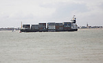 Large cargo ship loaded with containers leaving the Port of Felixstowe, Suffolk, England