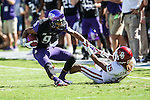 TCU Horned Frogs wide receiver Josh Doctson (9) and Oklahoma Sooners cornerback Zack Sanchez (15) in action during the game between the Oklahoma Sooners and the TCU Horned Frogs at the Amon G. Carter Stadium in Fort Worth, Texas. TCU defeats OU 37 to 33.
