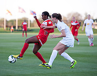 Katherine Reynolds (16) of the Western NY Flash applies pressure to Tiffany McCarty (14) of the Washington Spirit during the game at the Maryland SoccerPlex in Boyds, MD.  Washington tied Western NY, 1-1.