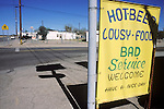 Hot Beer, Lousy Food, Bad Service, Welcome, Have a Nice Day, greets diners and drinkers to a road house along old Highway US 60 in rural Arizona