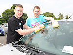 Niall Bayly and Darren Meegan who took part in the charity car wash in Termonfeckin in aid of Our Lady's Hospital for Sick Children