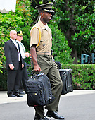 """United States President Barack Obama' traveling military aide carries the """"football"""", a top secret briefcase with information for the Commander-in-Chief, as the President departs the South Lawn of the White House in Washington, D.C. on Monday, August 3, 2010.  The President is traveling to Atlanta, Georgia to speak at the national convention of Disabled American Veterans. .Credit: Ron Sachs / Pool via CNP"""
