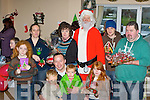 Santa Claus meets the traders and customers at the Castlemiane Christmas fair on Sunday was front row l-r: Adam, Emmet and Scott Spring, Caoimhe Brosnan. Back row; Donnchadh O'Connell, Elaine O'Connell, Mary O'Brien, Santa Claus, James Foley and Patrick McCarthy....