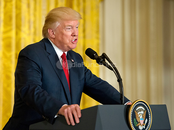 United States President Donald J. Trump conducts a joint press conference with Prime Minister Paolo Gentiloni of Italy  in the East Room of the White House in Washington, DC on Thursday, April 20, 2017.<br /> Credit: Ron Sachs / CNP /MediaPunch