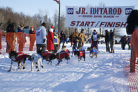 Saturday, February 24th, Knik, Alaska.  Jr. Iditarod musher Michael Miller leaves start line on Knik Lake