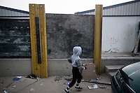 November 11, 2014 - Tripoli City, Libya: A Tawergha child is seen running in a construction site in the Fallah road of Tripoli used as a temporary shelter after the Tawerghans were forced to move from their city home as they were harassed by the armed militias of Misrata during the 2011 uprising against Colonel Gaddafi. (Photo/Narciso Contreras)