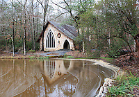 Stock photo: Small chapel in the wilderness of callaway gardens and its reflection in the pond in front.