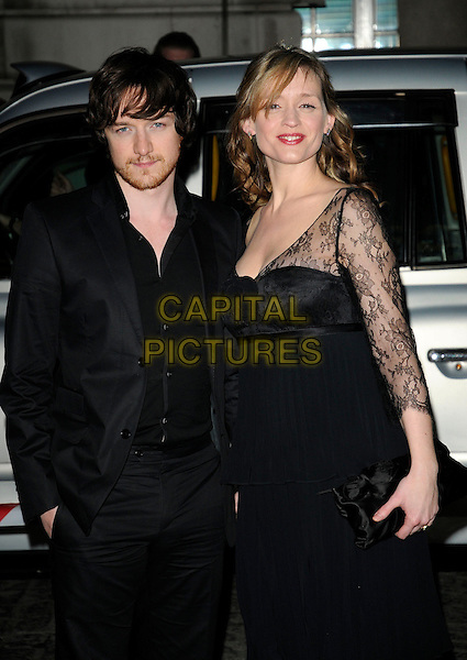 JAMES McAVOY & ANNE MARIE DUFF.The UK Premiere of 'The Last Station' at The Curzon Mayfair Cinema, London, England..January 26th 2010.half length black jacket dress lace clutch bag married husband wife beard facial hair suit.CAP/CAN.©Can Nguyen/Capital Pictures.