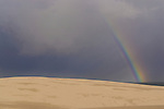 Rainbow amongst the sand dunes. Stockton Beach Sand dunes Worimi Conservation Lands. Anna Bay, Port Stephens, NSW, Australia.