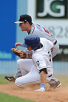 Rome Braves shortstop Matt Lipka  #5 applies a tag at second on a hard sliding Kyle Parker during a game against the Asheville Tourists at McCormick Field on June 26, 2011 in Asheville, North Carolina.  The Tourists won the game 4.  (Tony Farlow/Four Seam Images)