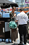 May 17th 2012 ..Jessica Alba carrying a green aqua blue turquise snake skin purse walking in Hollywood to pay valet parking..AbilityFilms@yahoo.com.www.AbilityFilms.com.805 427 3519