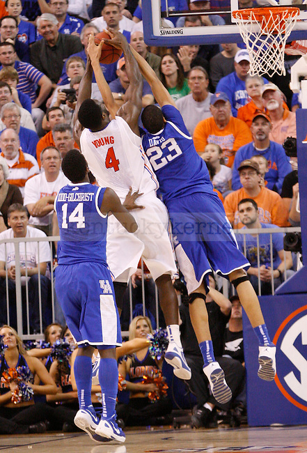 UK forward Anthony Davis gets the rebound over Florida's Patric Young during the second half of the University of Kentucky's men basketball game against University of Florida 3/4/12 at the O'Connell Center in Gainesville, Fl. Photo by Quianna Lige | Staff