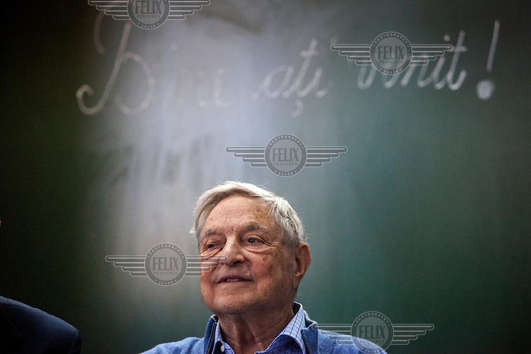 George Soros, chairman and founder of the Open Society Foundation, during his visit to a school, in the Roma district of Frumusani, funded by the  Roma Education Fund/, a charitable organisation whose aims are: 'Closing the gap in educational outcomes between Roma and non-Roma'.