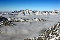 Swiss mountains covered with snow in front of a bright blue sky