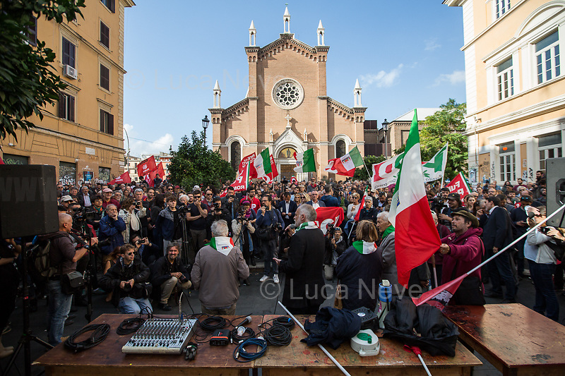 """Antifascist Partizans. Members of the Partigiani: the Italian Resistance during WWII.<br /> <br /> Roma, 27/10/2018. Today Members of the far-right/neo-fascist political party 'Forza Nuova' (New Force), held a demonstration at Porta Maggiore in Rome in response to the rape and murder of the 16-year-old Desiree Mariottini committed in San Lorenzo district Friday the 19th October. <br /> In the meantime, ANPI (National Association of Italian Partizans), supported by other anti-fascist / anti-racist organizations, social centres, trade unions, and political parties, held a counter-demonstration in the heart of San Lorenzo, Piazza dell'Immacolata. The demo was called to protest against the rally of Forza Nuova (New Force), accused to be a fascist group trying to exploit the death of Desiree Mariottini, to propose """"fascist patrols"""" ('ronde' in Italian) in the famous WWII-anti-fascist neighbourhood of San Lorenzo, and for """"narrow-minded slander"""" ('sciacallaggio' in Italian).  <br /> The heavy police presence, in full riot gears, kept the two sides apart. A small group of provocateurs, armed of two 'Forza Nuova' (New Force) flags, were blocked by anti-fascists and police while they were trying to reach the area where Desiree Mariottini was killed in Via dei Lucani 22.  <br /> The sixteen-year-old Desiree Mariottini was found dead in a derelict-abandoned building (known for drug trafficking) in San Lorenzo district on October 19. The Italian police, in connection with the murder, arrested four people, two Senegalese, one Nigerian and one Ghanaian nationals, who allegedly drugged and gang raped Desiree while unconscious, before she died of an alleged overdose (For more info BBC website, https://bbc.in/2O5Sf8l)."""