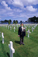 English veteran at graves of the heroes at Omaha Beach Memorial in Normandy France